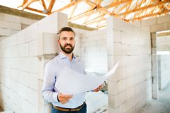Architect or home owner at the construction site. Stock Image