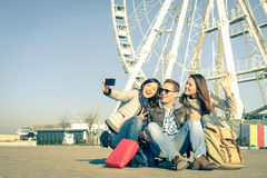 Young hipster best friends taking a selfie at luna park Stock Images
