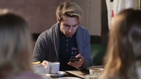 Young hipster browsing internet on smart phone stock footage