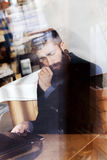 Young hipster businessman on break for a coffee Royalty Free Stock Photos