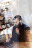 Young hipster businessman on break for a coffee Stock Photos