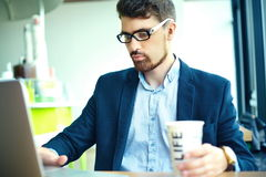 Young hipster businessman in cafe with notebook in suit Royalty Free Stock Photo