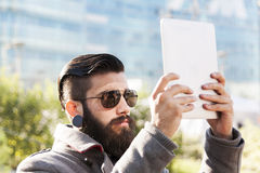 Young hipster businessman consults his laptop Stock Image