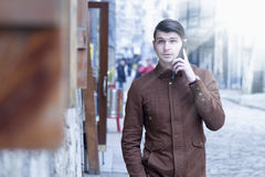 Young hipster businessman talking phone outdoors freedom, succe. Ss, job Royalty Free Stock Photo