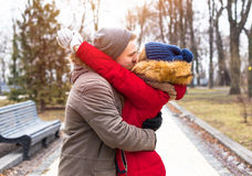 Young hipster couple enjoy in winter city park outdoor Stock Images