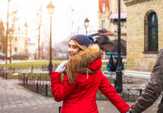 Young hipster couple enjoy in winter city park outdoor Royalty Free Stock Image