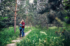 Young hipster couple in the forest Royalty Free Stock Photos