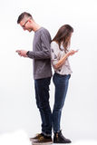 Young hipster couple  in love ignoring each other with phones. Stock Photo