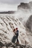 Young hipster couple in love kissing near famous Iceland Dettifoss waterfall