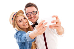 Young hipster couple making a selfie Royalty Free Stock Photography