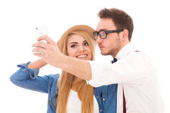 Young hipster couple making a selfie Royalty Free Stock Photo