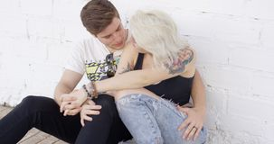 Young hipster couple sharing a quiet tender moment stock video footage