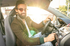 Young hipster fashion model driving car Royalty Free Stock Images