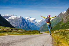 Young hipster female traveler enjoy the travel. Adventure is coming... Norway Royalty Free Stock Image