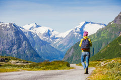 Young hipster female traveler on road. Adventure is coming stock photo
