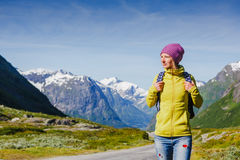 Young hipster female traveler on road stock image