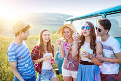 Young hipster friends on road trip Royalty Free Stock Images