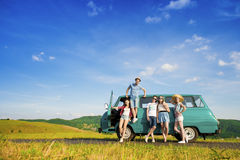Young hipster friends on road trip Royalty Free Stock Photo