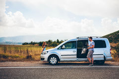 Young hipster friends on road trip on a summers day. Euro-trip. Young hipster friends on road trip on a summers day royalty free stock image