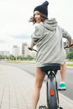 Young hipster girl with black bike Royalty Free Stock Images