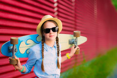 Young hipster girl with braids in sunglasses and straw hat Stock Image