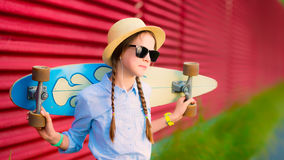 Young hipster girl with braids in sunglasses and straw hat Stock Photos