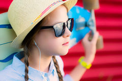 Young hipster girl with braids in sunglasses and straw hat Stock Photo