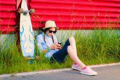 Young hipster girl with braids in sunglasses and straw hat Royalty Free Stock Photography