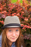 Young  hipster girl close-up portrait in autumn garden. Royalty Free Stock Photos