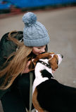 Young hipster girl with her pet estonian hound dog playing, junping and hugging and having fun outdoor at the old stadium. Stock Photography