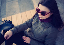 Young hipster girl in parka coat outdoors stock photo