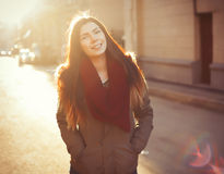 Young hipster girl in parka at sunny day Stock Photography