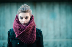 Young hipster girl posing with scarf. Young hipster girl with big burgundy scarf Royalty Free Stock Photos