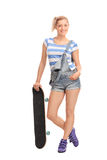 Young hipster girl posing with a skateboard Stock Images