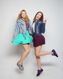 young hipster girls best friends jump Stock Photo