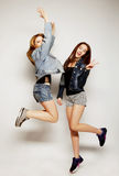 young hipster girls best friends jump Royalty Free Stock Image