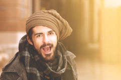 Young hipster guy having fun shouting in instagram tones. Hipster man having fun shouting in the city instagram tones Stock Photos