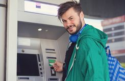 Content man using ATM machine successfully royalty free stock image