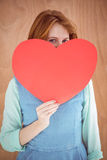 Young hipster holding a red heart shape Royalty Free Stock Photos