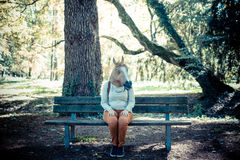 Young hipster horse mask woman in autumn royalty free stock photo
