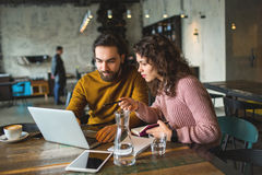 Young hipster male and female working laptop together in cafe Stock Photography