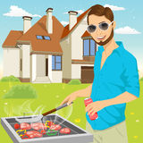 Young hipster man barbecuing meat on the grill Royalty Free Stock Images