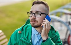 Young hipster man calling on smartphone Royalty Free Stock Images