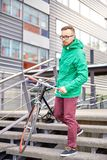 Young hipster man carrying fixed gear bike in city Royalty Free Stock Photo