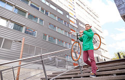 Young hipster man carrying fixed gear bike in city Stock Photography