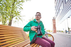 Young hipster man with digital camera in city Stock Photo