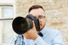 Young hipster man with digital camera in city Royalty Free Stock Photo