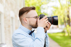 Young hipster man with digital camera in city Stock Photography