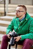 Young hipster man with digital camera in city Stock Photos