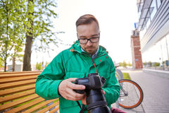 Young hipster man with digital camera in city Stock Image